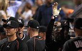 Adeiny Hechavarria of the Miami Marlins reacts to scoring on a single by Jose Fernandez during a game against the New York Mets at Marlins Park on...