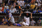 Adeiny Hechavarria of the Miami Marlins scores on a single by Jose Fernandez during a game against the New York Mets at Marlins Park on July 23 2016...
