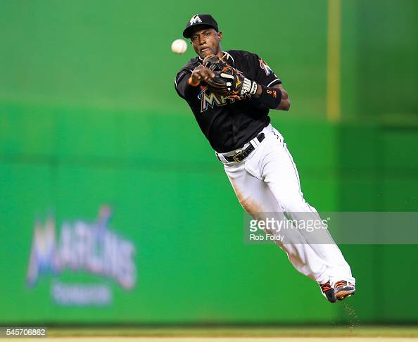 Adeiny Hechavarria of the Miami Marlins throws to first base during the second inning of the game against the Cincinnati Reds at Marlins Park on July...