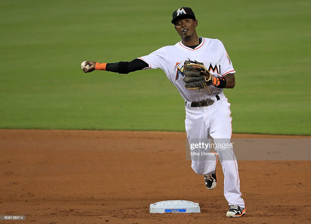 Adeiny Hechavarria #3 of the Miami Marlins turns a double play during a game against the Washington Nationals at Marlins Park on September 19, 2016 in Miami, Florida.