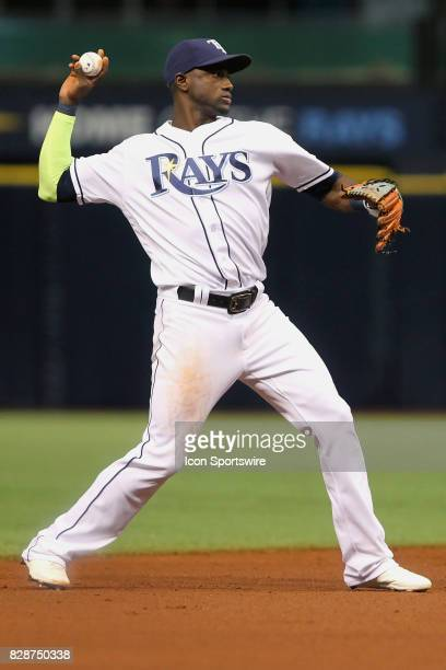 Adeiny Hechavarria of the Rays sets up to throw the ball over to first base during the MLB regular season game between the Boston Red Sox and Tampa...