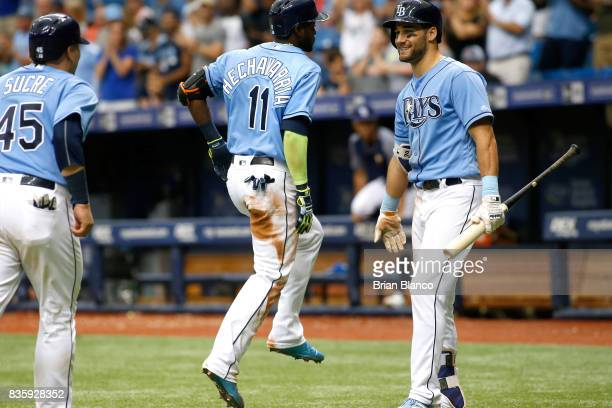Adeiny Hechavarria of the Tampa Bay Rays celebrates with teammates Jesus Sucre and Kevin Kiermaier after hitting a tworun home run off of pitcher...