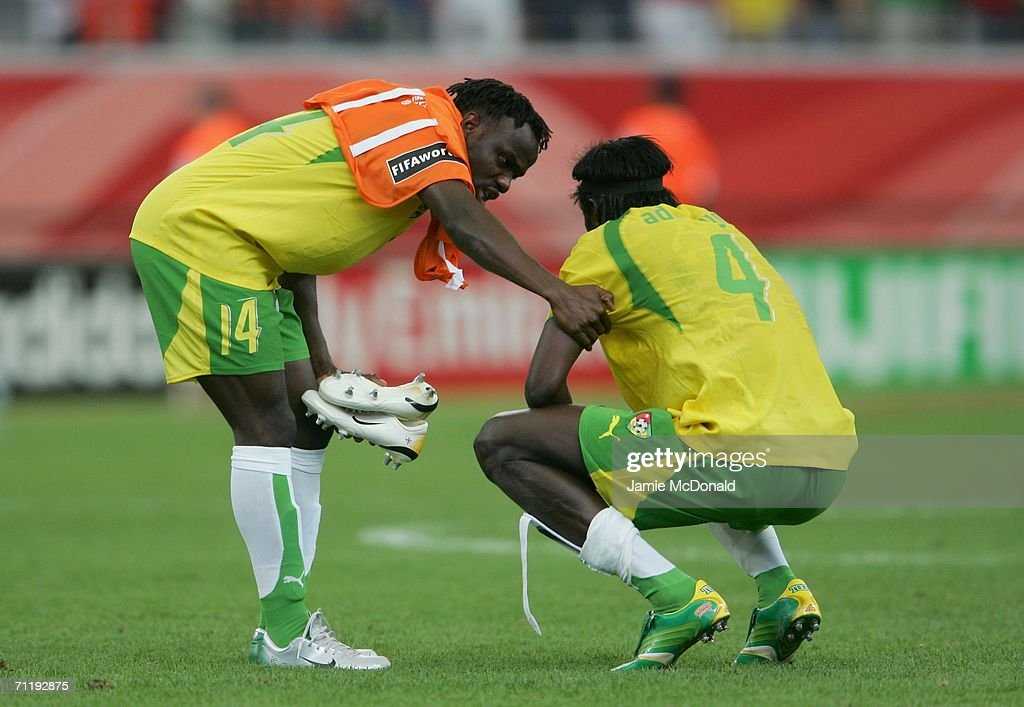 Adekanmi Olufade (L) and Emmanuel Adebayor (4) of Togo looks dejected after the FIFA World Cup Germany 2006 Group G match between South Korea and Togo which Togo lost 1-0 at the Stadium Frankfurt on June 13, 2006 in Frankfurt, Germany.