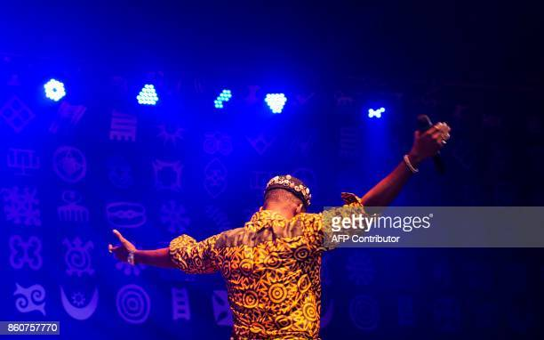 Adekunle Gold and his 79th Element Band perform at the 'Afrika Shrine' dedicated to the pioneer of Afrobeat Fela Anikulapo Kuti during the annual...
