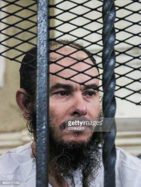 CORRECTION Adel Abu alNur a 50yearold Egyptian defendant sits behind bars in a courthouse on March 9 2017 where he was sentenced to death during his...