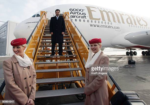 Adel Al Redha executive vice president Emirates engineering and operations pose in front of the aircraft during the hand over of the A380 to the...