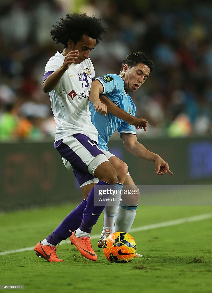 Adel Gamal of Al Ain is tackled by Samir Nasri of Manchester City during the friendly match between Al Ain and Manchester City at Hazza bin Zayed Stadium on May 15, 2014 in Al Ain, United Arab Emirates.