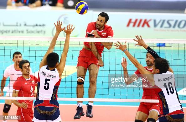 Adel Gholami in Action during 17th Asian Men's Volleyball Championship between Iran And Korea on October 6 2013 in Dubai United Arab Emirates