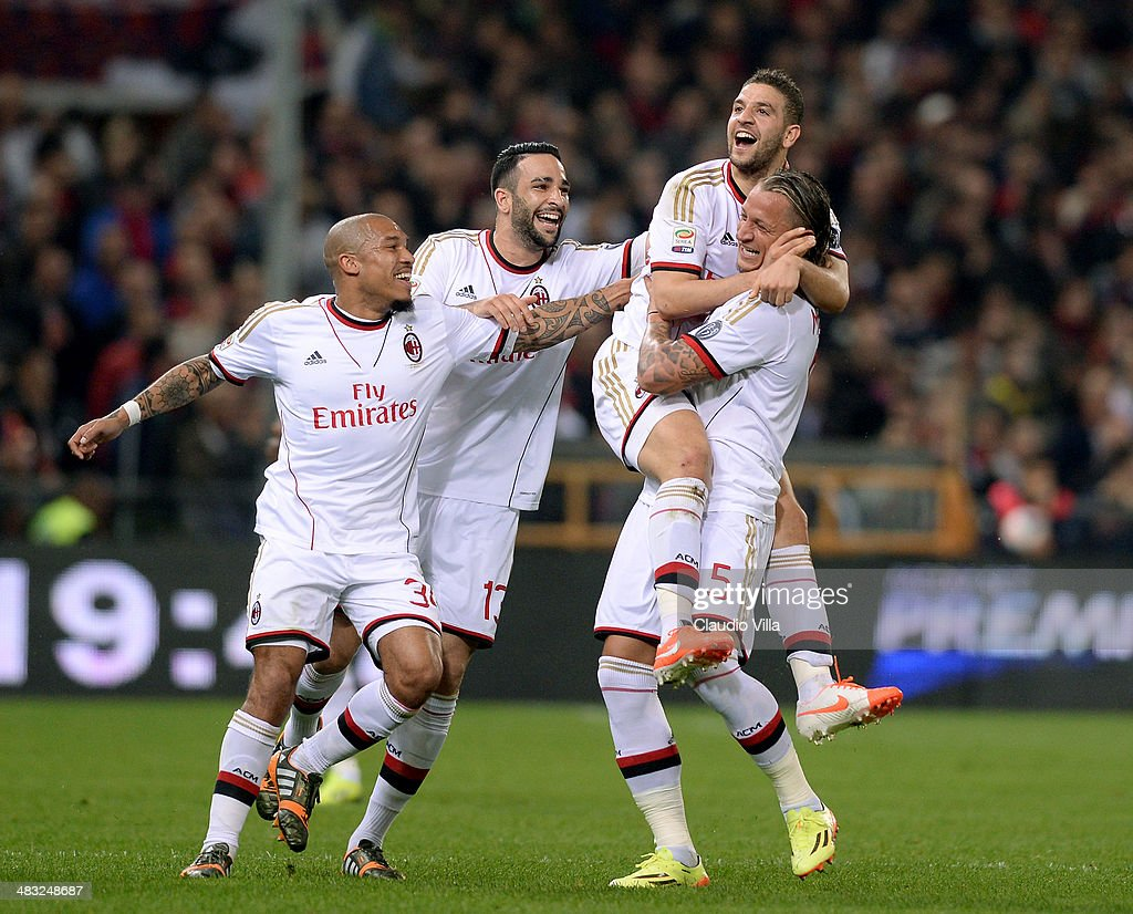 <a gi-track='captionPersonalityLinkClicked' href=/galleries/search?phrase=Adel+Taarabt&family=editorial&specificpeople=3275547 ng-click='$event.stopPropagation()'>Adel Taarabt</a> of AC Milan (C) celebrates scoring the first goal during the Serie A match between Genoa CFC v AC Milan at Stadio Luigi Ferraris on April 7, 2014 in Genoa, Italy.