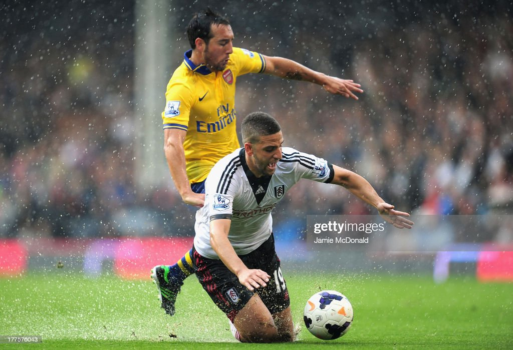 <a gi-track='captionPersonalityLinkClicked' href=/galleries/search?phrase=Adel+Taarabt&family=editorial&specificpeople=3275547 ng-click='$event.stopPropagation()'>Adel Taarabt</a> of Fulham and <a gi-track='captionPersonalityLinkClicked' href=/galleries/search?phrase=Santi+Cazorla&family=editorial&specificpeople=709830 ng-click='$event.stopPropagation()'>Santi Cazorla</a> of Arsenal battle for the ball during the Barclays Premier League match between Fulham and Arsenal at Craven Cottage on August 24, 2013 in London, England.