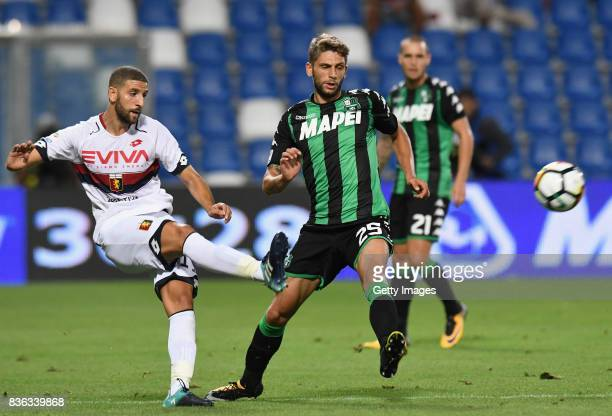 Adel Taarabt of Genoa CFC competes for the ball whit'n Domenico Berardi of US Sassuolo during the Serie A match between US Sassuolo and Genoa CFC at...