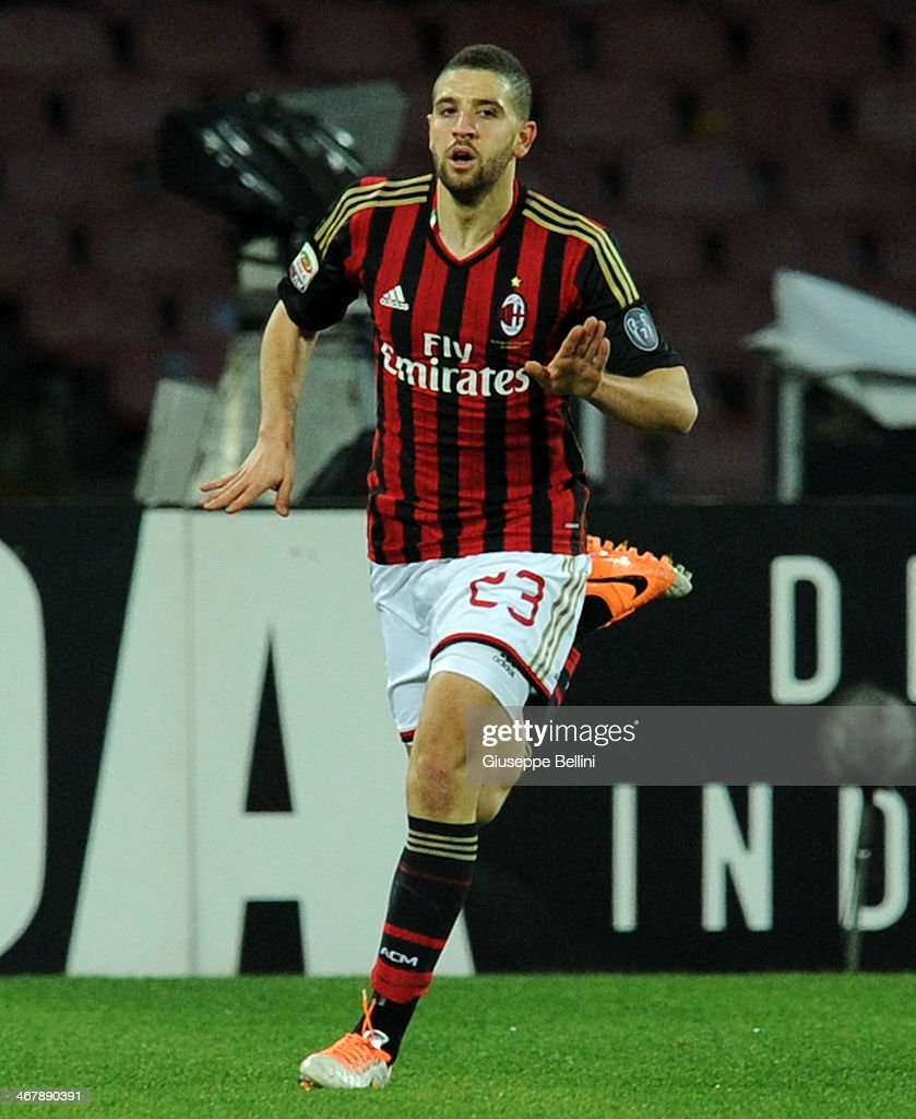 <a gi-track='captionPersonalityLinkClicked' href=/galleries/search?phrase=Adel+Taarabt&family=editorial&specificpeople=3275547 ng-click='$event.stopPropagation()'>Adel Taarabt</a> of Milan celebrates after scoring the opening goal during the Serie A match between SSC Napoli and AC Milan at Stadio San Paolo on February 8, 2014 in Naples, Italy.