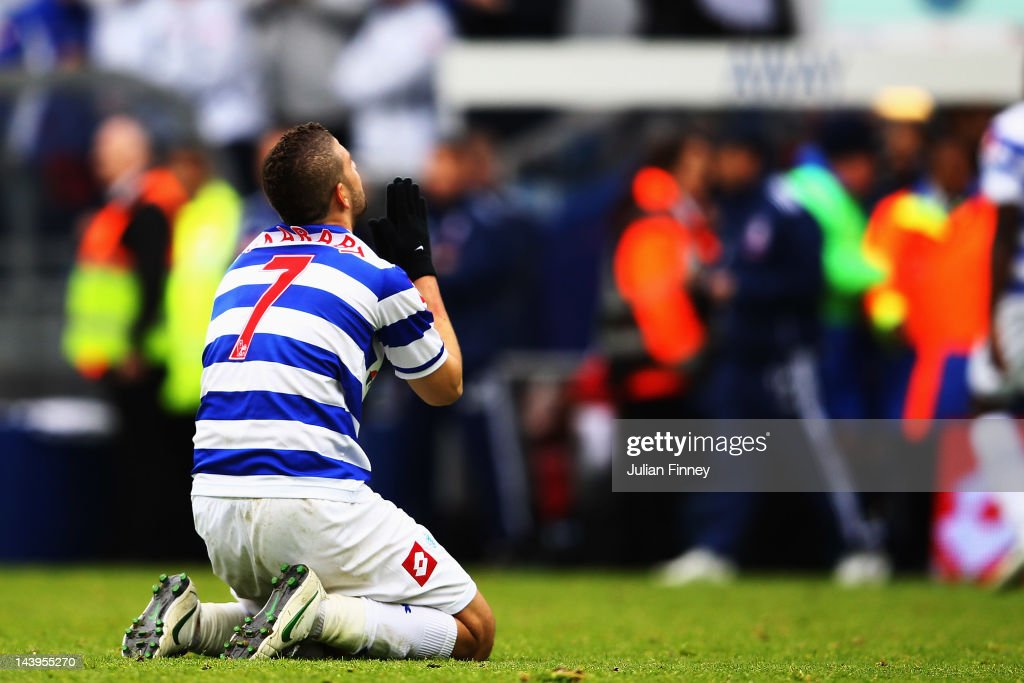 <a gi-track='captionPersonalityLinkClicked' href=/galleries/search?phrase=Adel+Taarabt&family=editorial&specificpeople=3275547 ng-click='$event.stopPropagation()'>Adel Taarabt</a> of Queens Park Rangers celebrates after team mate Djibril Cisse scores the only goal of the game during the Barclays Premier League match between Queens Park Rangers and Stoke City at Loftus Road on May 6, 2012 in London, England.