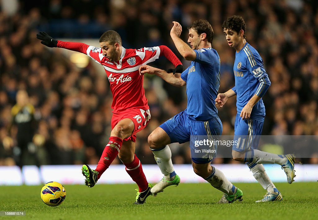 Adel Taarabt of Queens Park Rangers holds off Branislav Ivanovic of Chelsea during the Barclays Premier League match between Chelsea and Queens Park Rangers at Stamford Bridge on January 2, 2013 in London, England.