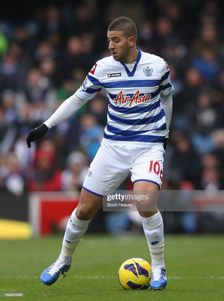 <a gi-track='captionPersonalityLinkClicked' href=/galleries/search?phrase=Adel+Taarabt&family=editorial&specificpeople=3275547 ng-click='$event.stopPropagation()'>Adel Taarabt</a> of Queens Park Rangers in action during the Barclays Premier League match between Queens Park Rangers and Reading at Loftus Road on November 4, 2012 in London, England.