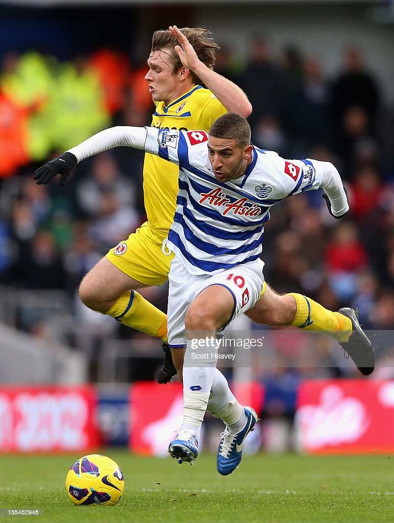 <a gi-track='captionPersonalityLinkClicked' href=/galleries/search?phrase=Adel+Taarabt&family=editorial&specificpeople=3275547 ng-click='$event.stopPropagation()'>Adel Taarabt</a> of Queens Park Rangers is challenged by <a gi-track='captionPersonalityLinkClicked' href=/galleries/search?phrase=Jay+Tabb&family=editorial&specificpeople=638761 ng-click='$event.stopPropagation()'>Jay Tabb</a> of Reading during the Barclays Premier League match between Queens Park Rangers and Reading at Loftus Road on November 4, 2012 in London, England.