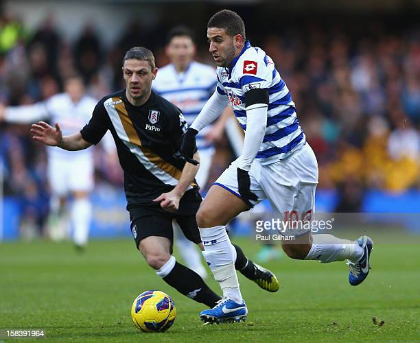 Adel Taarabt of Queens Park Rangers is closed down by Chris Baird of Fulham during the Barclays Premier League match between Queens Park Rangers and...