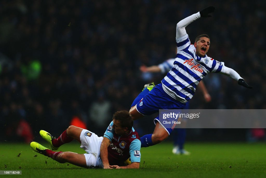 <a gi-track='captionPersonalityLinkClicked' href=/galleries/search?phrase=Adel+Taarabt&family=editorial&specificpeople=3275547 ng-click='$event.stopPropagation()'>Adel Taarabt</a> (R) of Queens Park Rangers is tackled by <a gi-track='captionPersonalityLinkClicked' href=/galleries/search?phrase=Mark+Noble&family=editorial&specificpeople=844055 ng-click='$event.stopPropagation()'>Mark Noble</a> (L) of West Ham United during the Barclays Premier League match between West Ham United and Queens Park Rangers at Upton Park on January 19, 2013 in London, England.