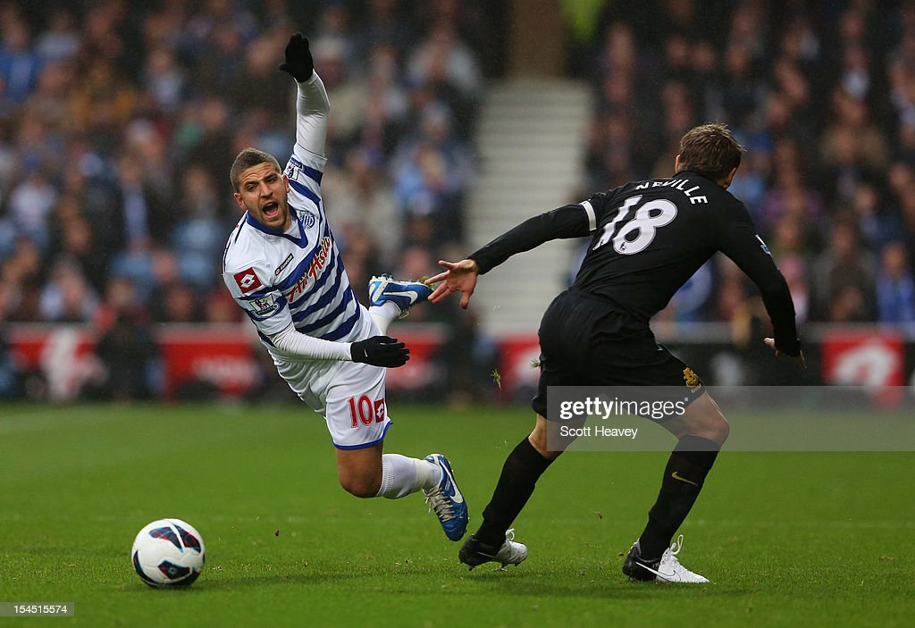 <a gi-track='captionPersonalityLinkClicked' href=/galleries/search?phrase=Adel+Taarabt&family=editorial&specificpeople=3275547 ng-click='$event.stopPropagation()'>Adel Taarabt</a> of Queens Park Rangers is tripped by <a gi-track='captionPersonalityLinkClicked' href=/galleries/search?phrase=Phil+Neville&family=editorial&specificpeople=201898 ng-click='$event.stopPropagation()'>Phil Neville</a> of Everton during the Barclays Premier League match between Queens Park Rangers and Everton at Loftus Road on October 21, 2012 in London, England.