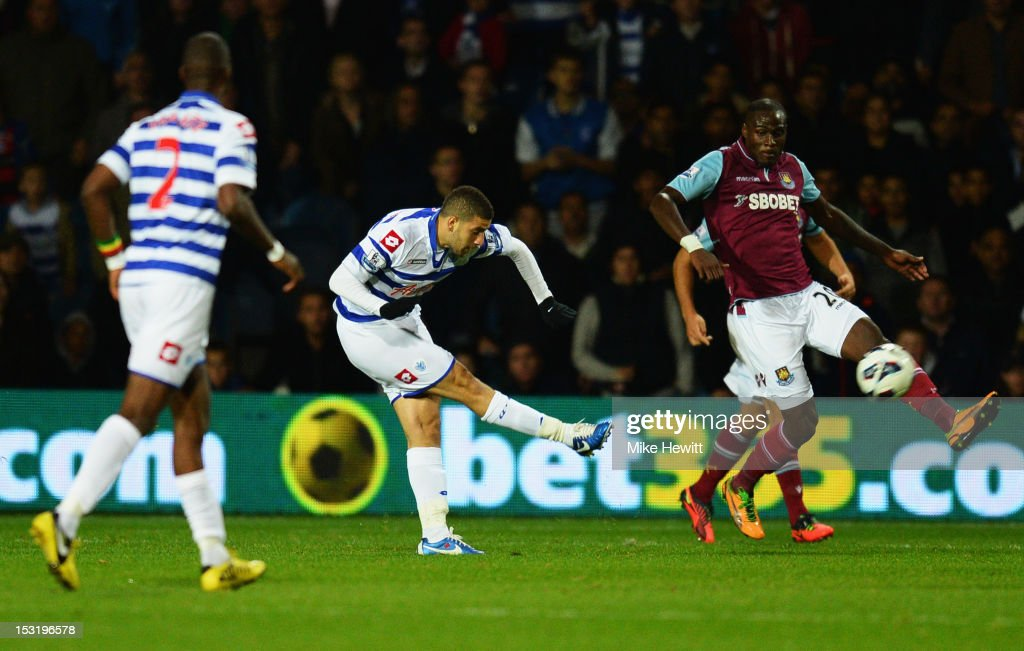 <a gi-track='captionPersonalityLinkClicked' href=/galleries/search?phrase=Adel+Taarabt&family=editorial&specificpeople=3275547 ng-click='$event.stopPropagation()'>Adel Taarabt</a> of Queens Park Rangers (C) scores their first goal during the Barclays Premier League match between Queens Park Rangers and West Ham United at Loftus Road on October 1, 2012 in London, England.