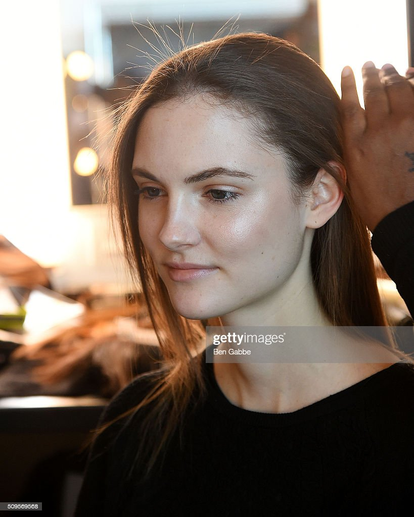 Adela Novotna from the Czech Republic prepares backstage at the Mathieu Mirano presentation during Fall 2016 New York Fashion Week at Pier 59 Studios on February 11, 2016 in New York City.