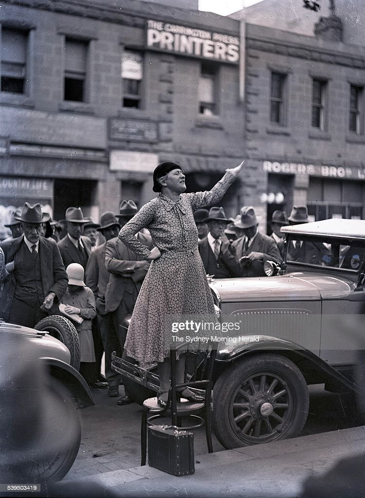 Adela Pankhurst Walsh, the daughter of Emily Pankhurst AKA Emmeline Pankhurst, the famous English suffragette, and younger sister of Christabel and Sylvia Pankhurst standing on a chair in the street outside The Carrington Press Printers talking to people on 28 January 1941. SMH NEWS Picture by STAFF