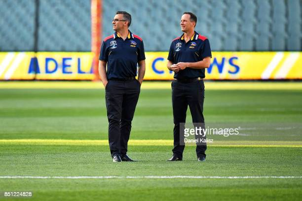 Adelaide Crows Assistant Coach Scott Camporeale and Adelaide Crows Senior Coach Don Pyke look on from the middle of Adelaide Oval prior to the First...