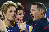 Adelaide Crows Head Coach Don Pike speaks to his players during the round 18 AFL match between the Geelong Cats and the Adelaide Crows at Simonds...