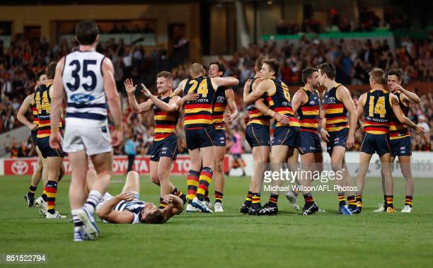 Adelaide Crows players celebrate as Patrick Dangerfield of the Cats looks on as the final siren sounds during the 2017 AFL First Preliminary Final...