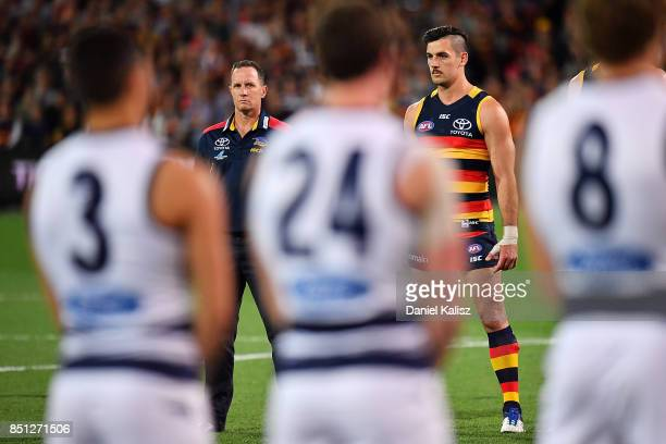 Adelaide Crows Senior Coach Don Pyke and Taylor Walker of the Crows looks on during the national anthem prior to the First AFL Preliminary Final...