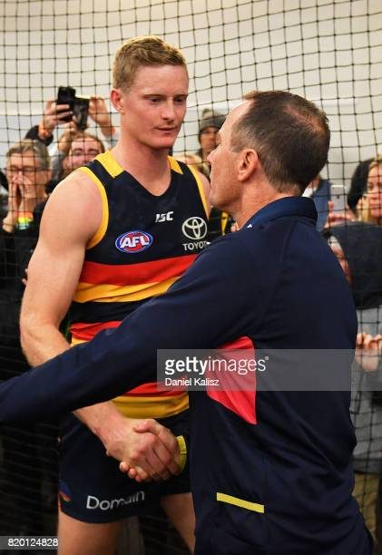 Adelaide Crows Senior Coach Don Pyke congratulates Alex Keath of the Crows after the round 18 AFL match between the Adelaide Crows and the Geelong...