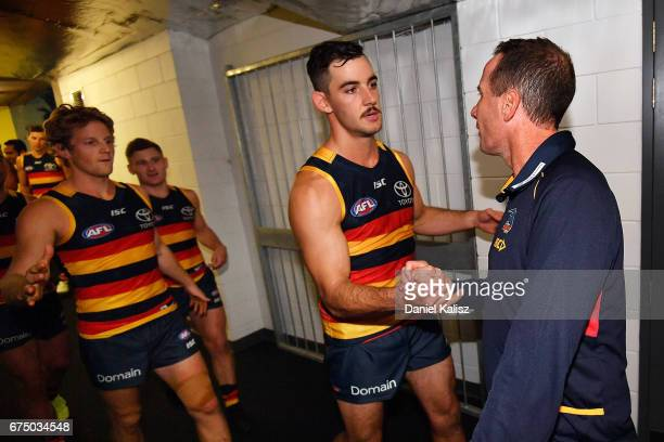 Adelaide Crows Senior Coach Don Pyke congratulates Taylor Walker and Rory Sloane of the Crows after the round six AFL match between the Adelaide...