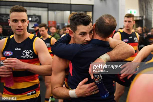 Adelaide Crows Senior Coach Don Pyke congratulates Taylor Walker of the Crows after the round 18 AFL match between the Adelaide Crows and the Geelong...