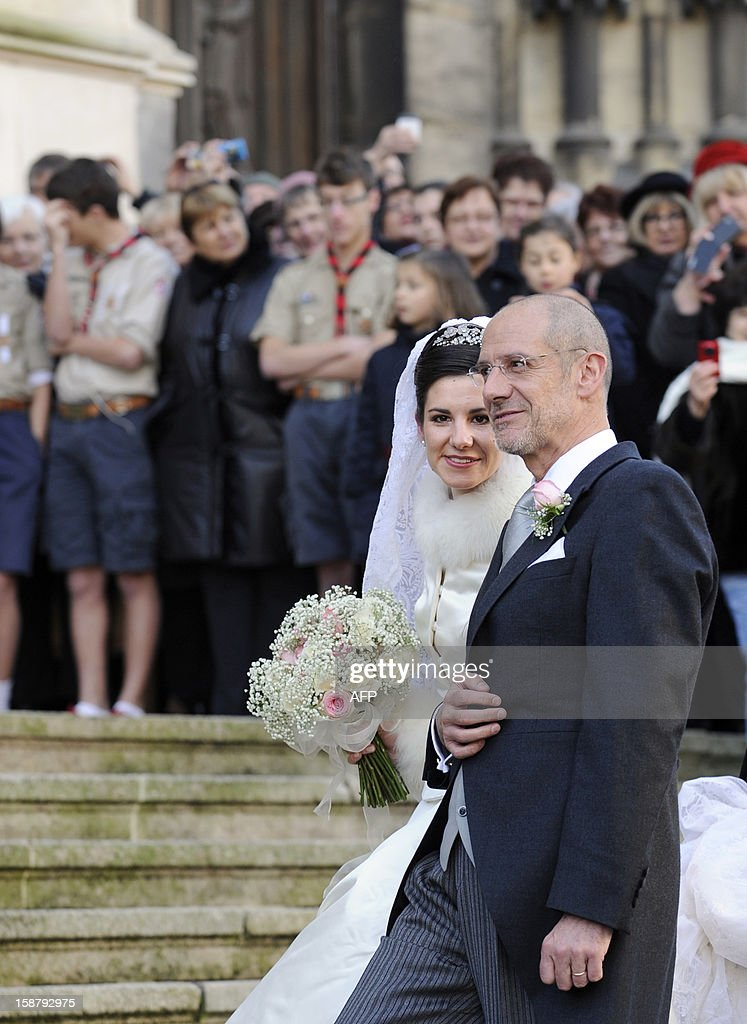 Adelaide Drape-Frisch arrives with her father Philippe Drape-Frisch in front of the Saint Epvre Basilica before her wedding with Archduke of Austria Christoph of Habsbourg, on December 29, 2012 in Nancy.