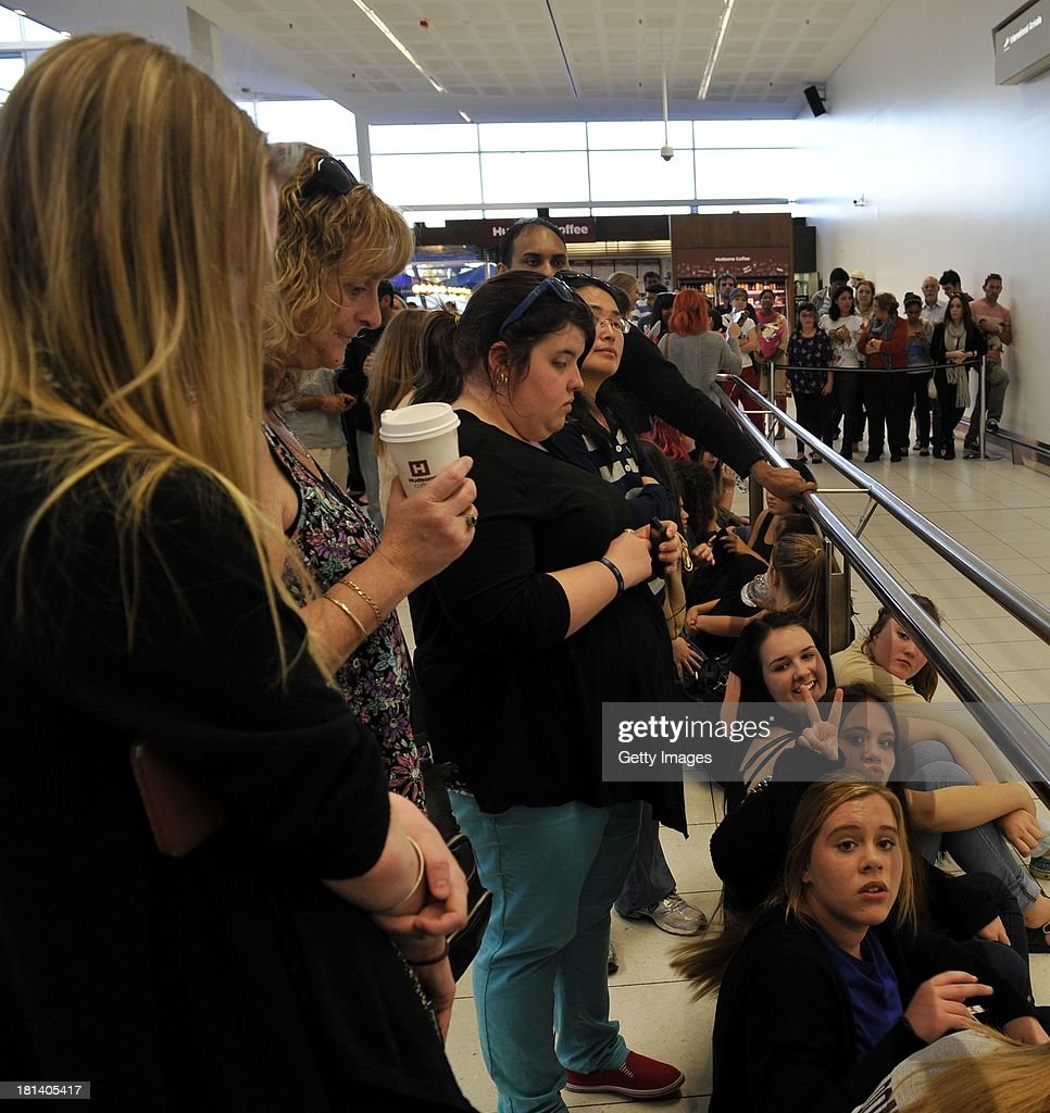 Adelaide fans of One Direction wait patiently at Adelaide Airport for their idols to arrive on September 21, 2013 in Adelaide, Australia.