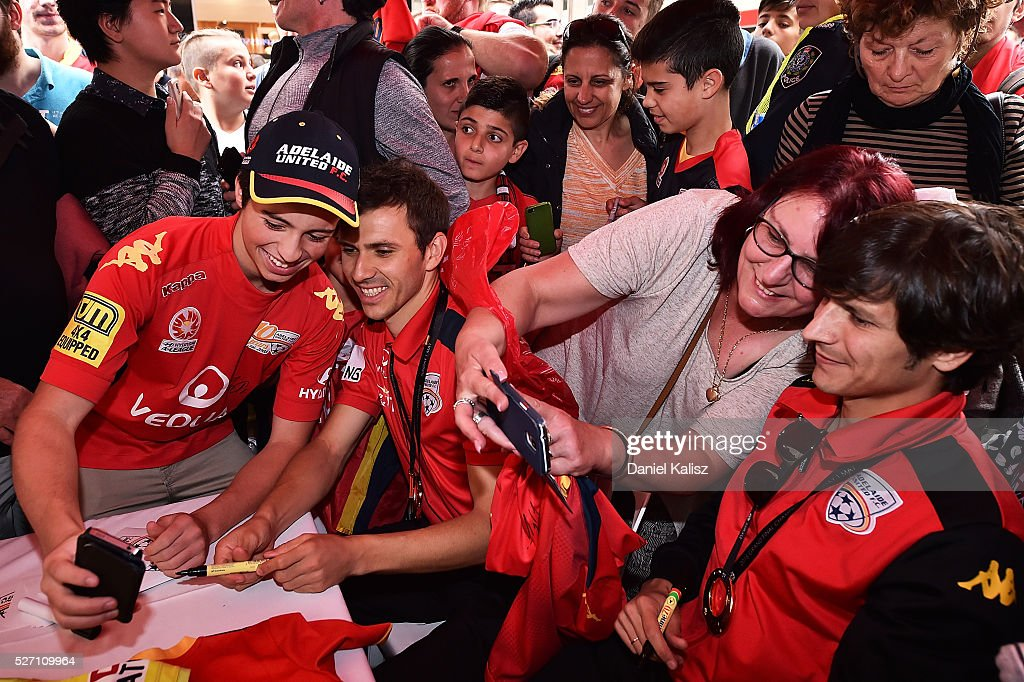 Adelaide fans receive autographs from Isaas Sanchez and Pablo Sanchez Alberto of United during the Adelaide United A-League Grand Final at Rundle Mall on May 2, 2016 in Adelaide, Australia.