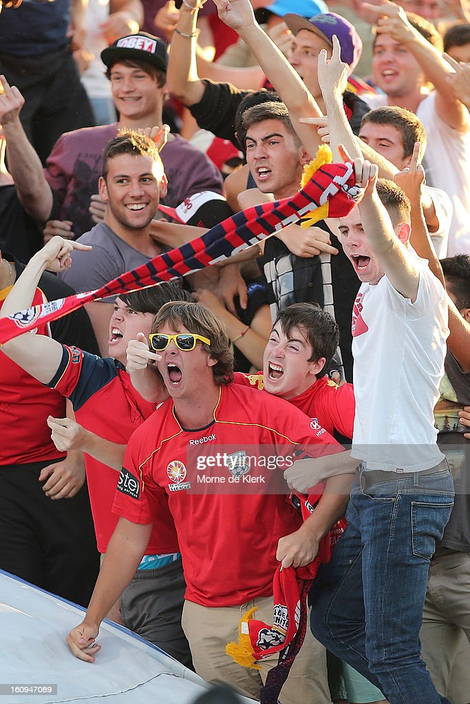 Adelaide fans taunt the Melbourne fans after Adelaide United scored a goal during the round 20 A-League match between Adelaide United and the Melbourne Victory at Hindmarsh Stadium on February 8, 2013 in Adelaide, Australia.