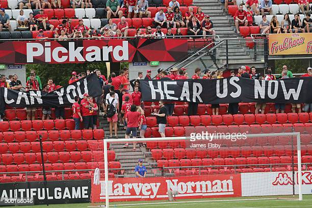 Adelaide fans walk out at the minute mark during the round nine ALeague match between Adelaide United and Perth Glory at Coopers Stadium on December...