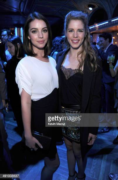 Adelaide Kane and Emily Bett Rickards attend The CW Network's 2014 Upfront party at Paramount Hotel on May 15 2014 in New York City