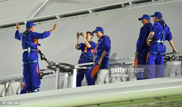 Adelaide Oval roof climbers have their picture taken during day two of the Four Day Tour match between the Cricket Australia XI and England at...