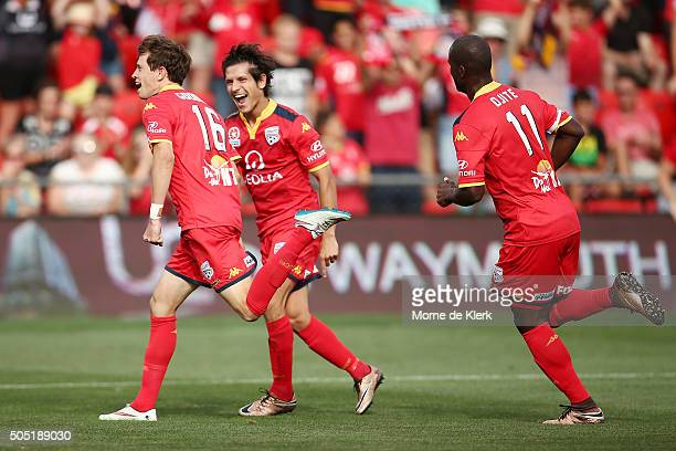 Adelaide players celebrate a goal by Craig Goodwin during the round 15 ALeague match between Adelaide United and the Central Coast Mariners at...