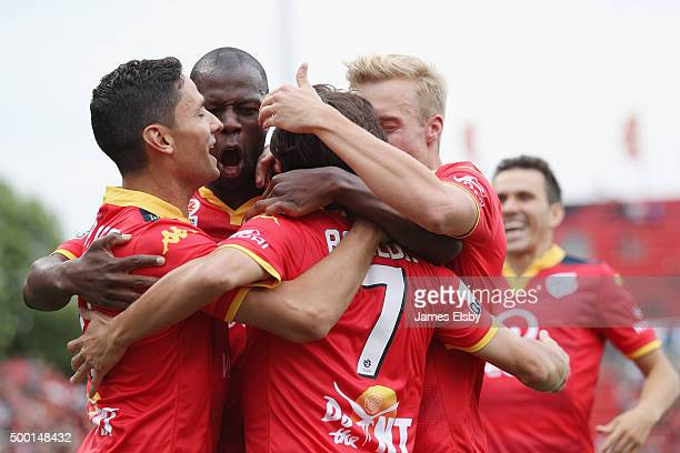 Adelaide players celebrate a goal during the round nine ALeague match between Adelaide United and Perth Glory at Coopers Stadium on December 6 2015...