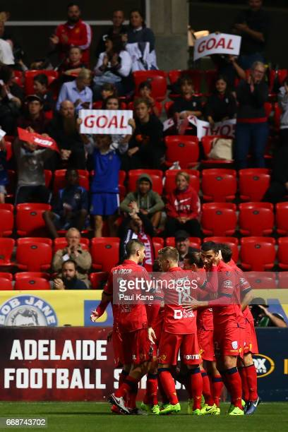 Adelaide players celebrate a successful penalty goal by Marcelo Carrusca during the round 27 ALeague match between Adelaide United and the Western...