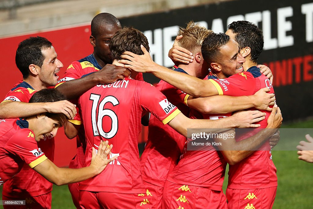 Adelaide players celebrate after Craig Goodwin scored a goal during the round 21 ALeague match between Adelaide United and the Central Coast Mariners...
