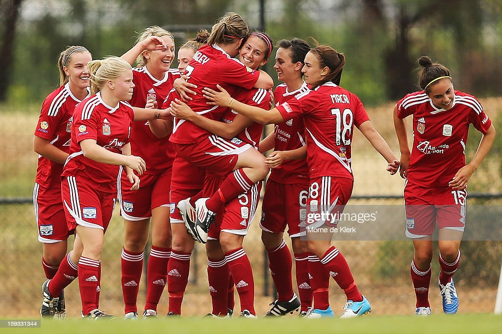 Adelaide players celebrate after Racheal Quigley scored a goal during the round 12 W-League match between Adelaide United and the Perth Glory at Burton Park on January 12, 2013 in Adelaide, Australia.