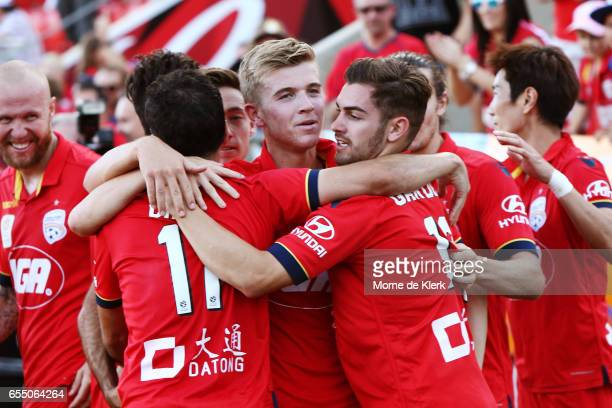 Adelaide players celebrate after Sergio Cirio scored a goal to win the round 23 ALeague match between Adelaide United and the Brisbane Roar at...