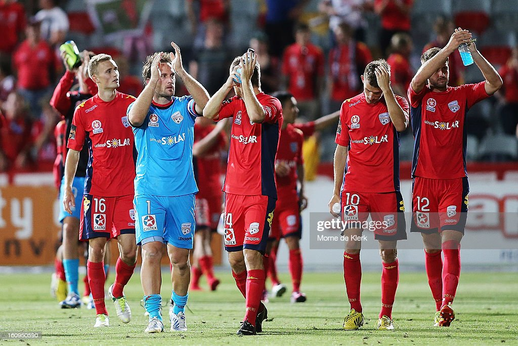 Adelaide players celebrate after the round 20 A-League match between Adelaide United and the Melbourne Victory at Hindmarsh Stadium on February 8, 2013 in Adelaide, Australia.