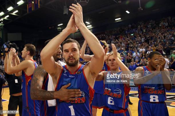 Adelaide players celebrate after winning game three of the NBL Semi Final series between the Adelaide 36ers and the Melbourne Tigers at Adelaide...