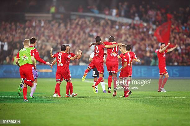 Adelaide players celebrate after winning the 2015/16 ALeague Grand Final match between Adelaide United and the Western Sydney Wanderers at the...