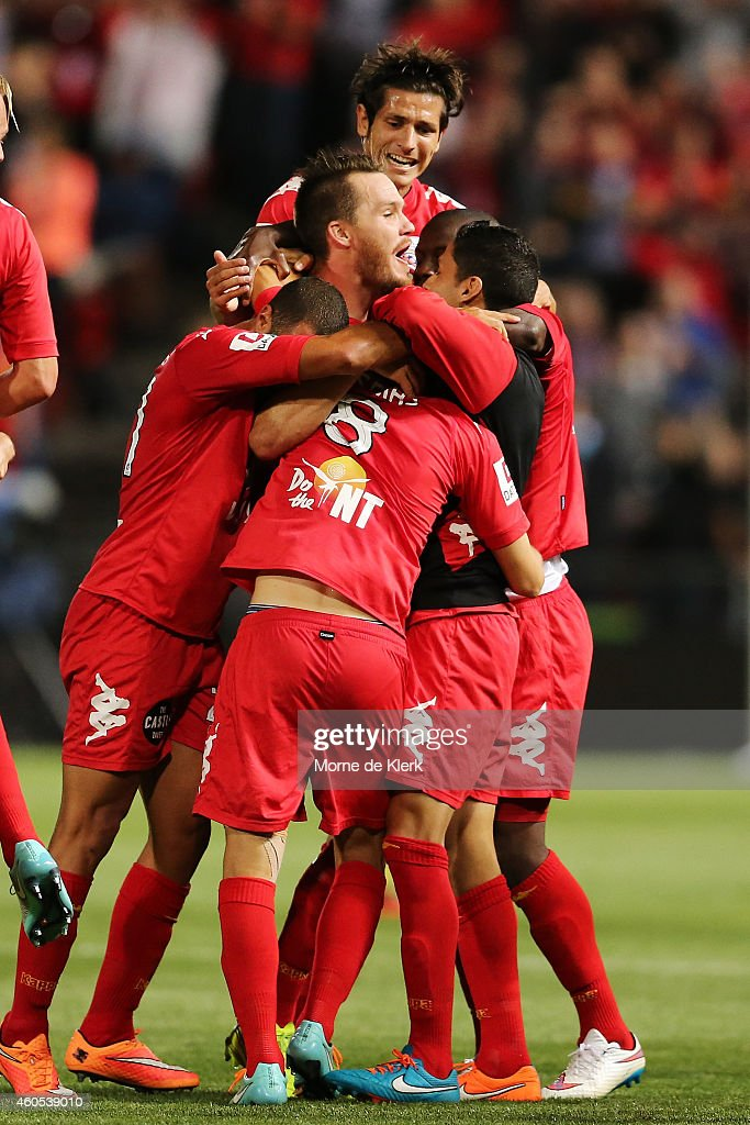 Adelaide players celebrate after winning the FFA Cup Final match between Adelaide United and Perth Glory at Coopers Stadium on December 16, 2014 in Adelaide, Australia.